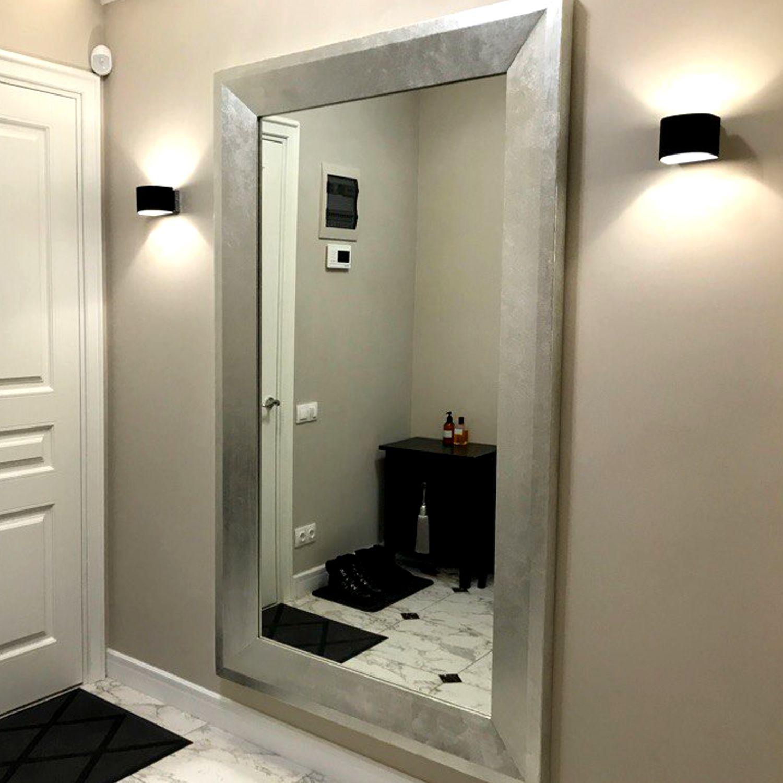 Большое зеркало в деревянной раме с серебрением