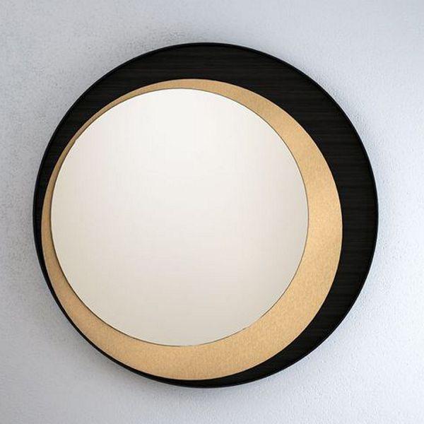 Круглое зеркало в раме с черным и золотым декором